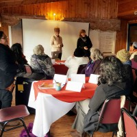 Jennifer and Karen speak to program members on day 1 of ASSET training.