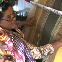 Woman artisan weaving